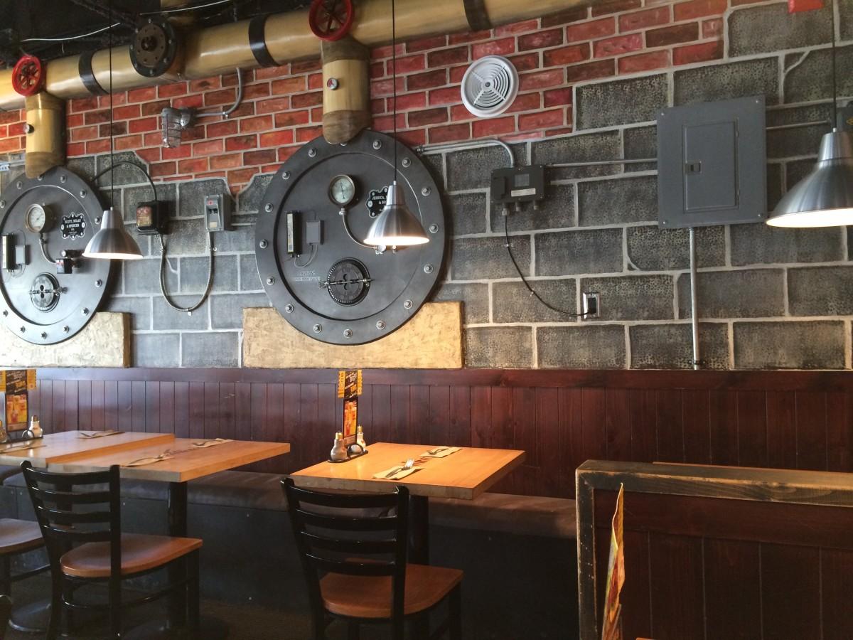 The restaurant has a mechanical room theme