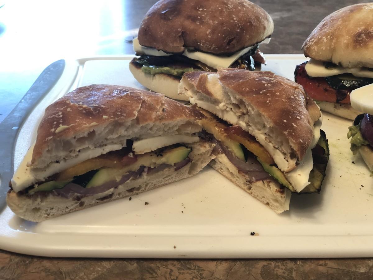 Grilled vegetables, mozzarella, and pesto on ciabatta bread