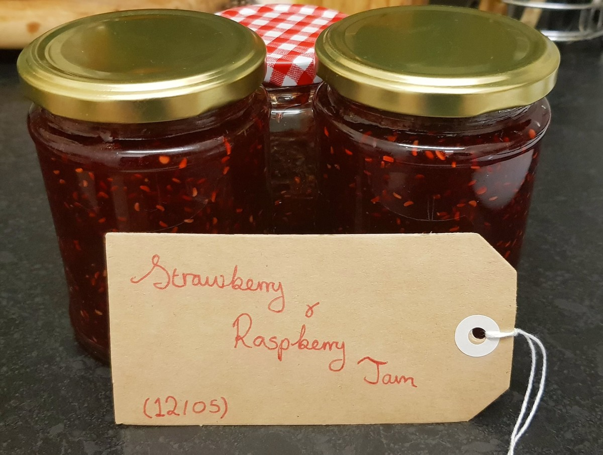 Some of the jars of strawberry and raspberry jam that I made with my latest batch, labelled.