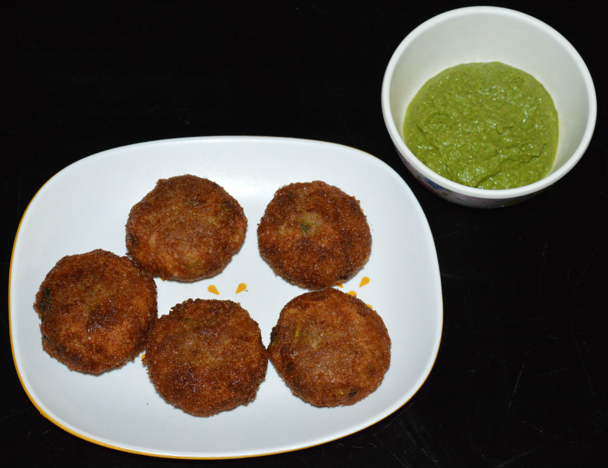 Aloo chop (potato croquettes) served with green chutney.