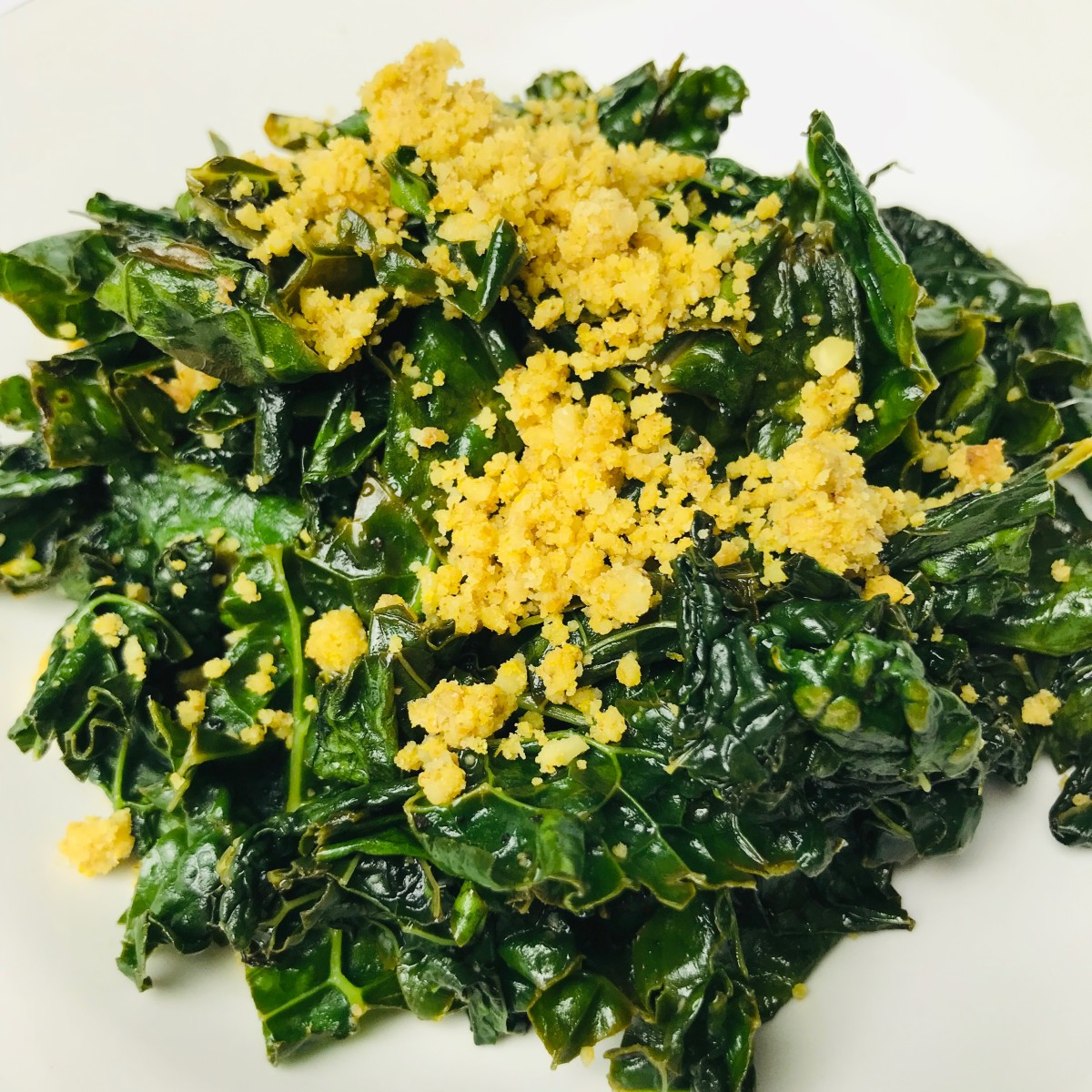 Sauteed kale topped with vegan walnut Parmesan.