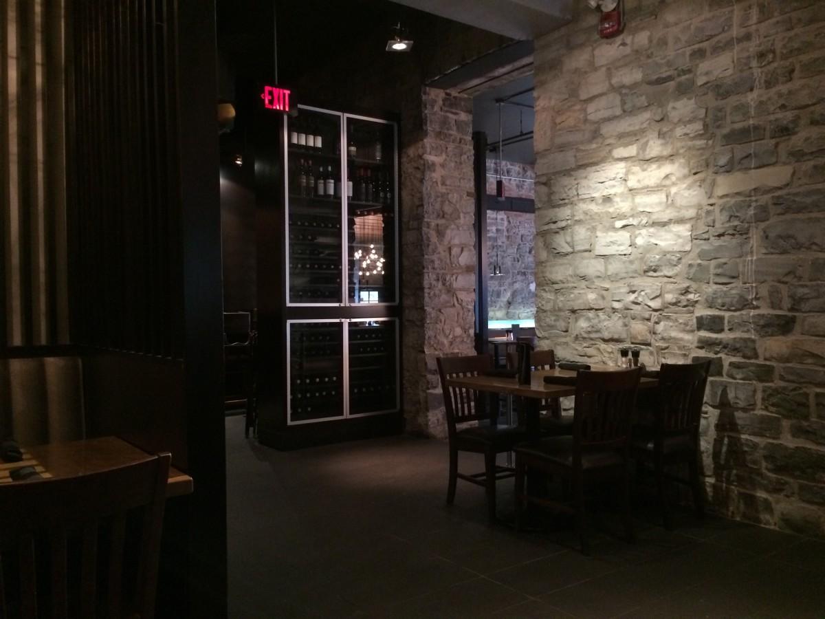 The restaurant's interior features exposed limestone.