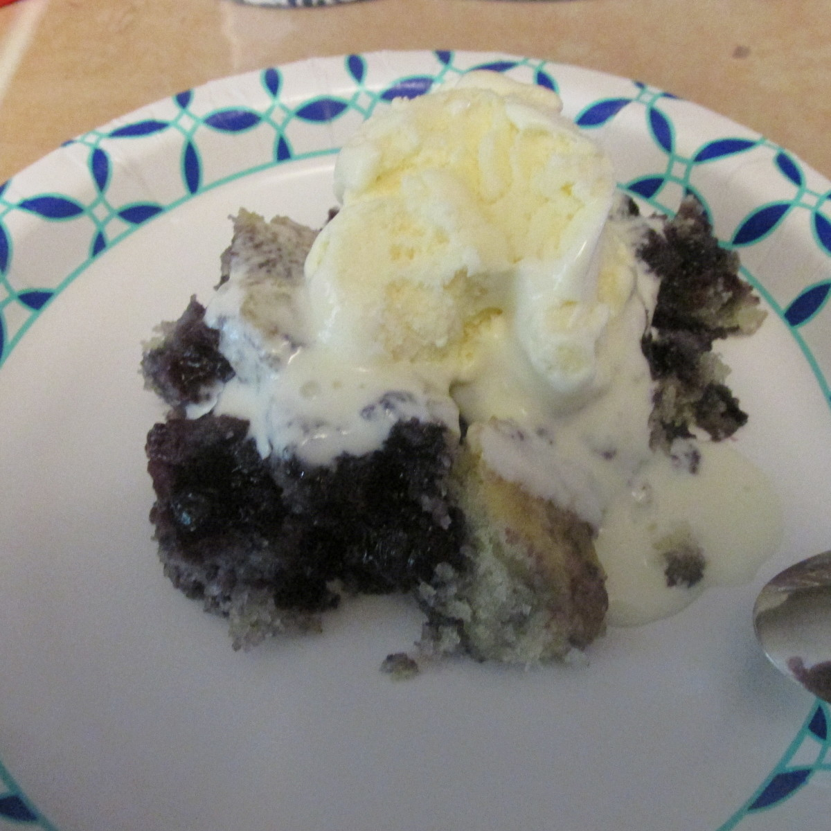 Warm blueberry cobbler topped with vanilla ice cream.