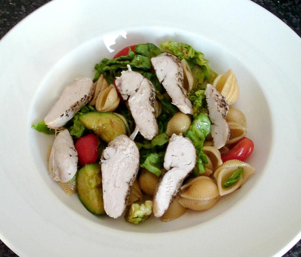Cold chicken breast strips and conchiglie pasta summer salad