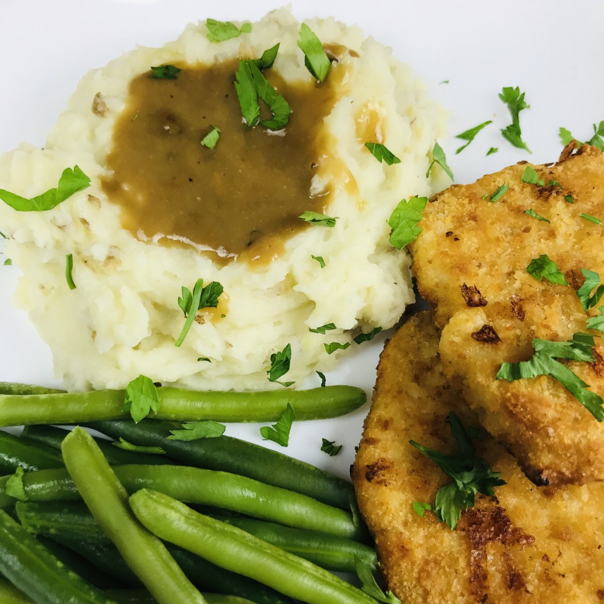 Creamy whipped potatoes with steamed green beans and Gardein Turk'y Cutlets.
