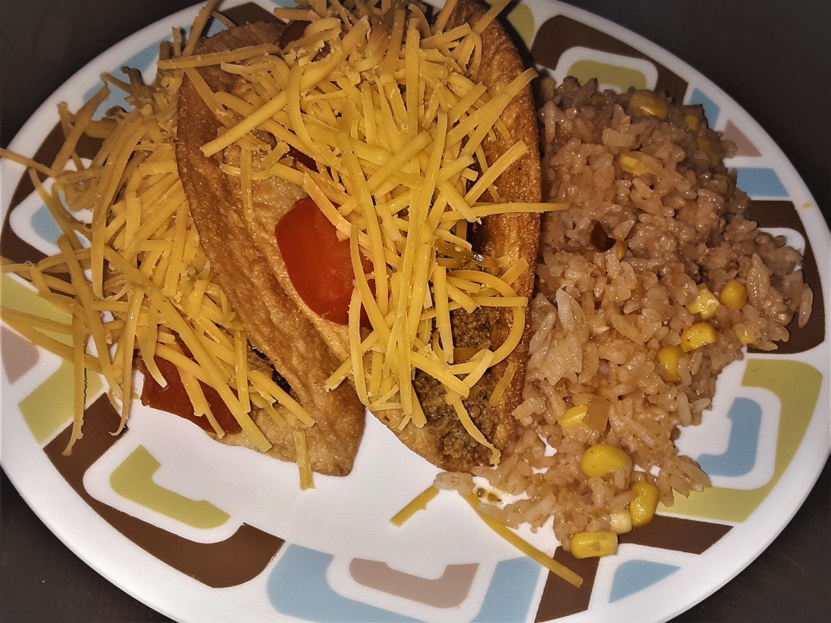 Ground turkey and black bean tacos served with Spanish rice