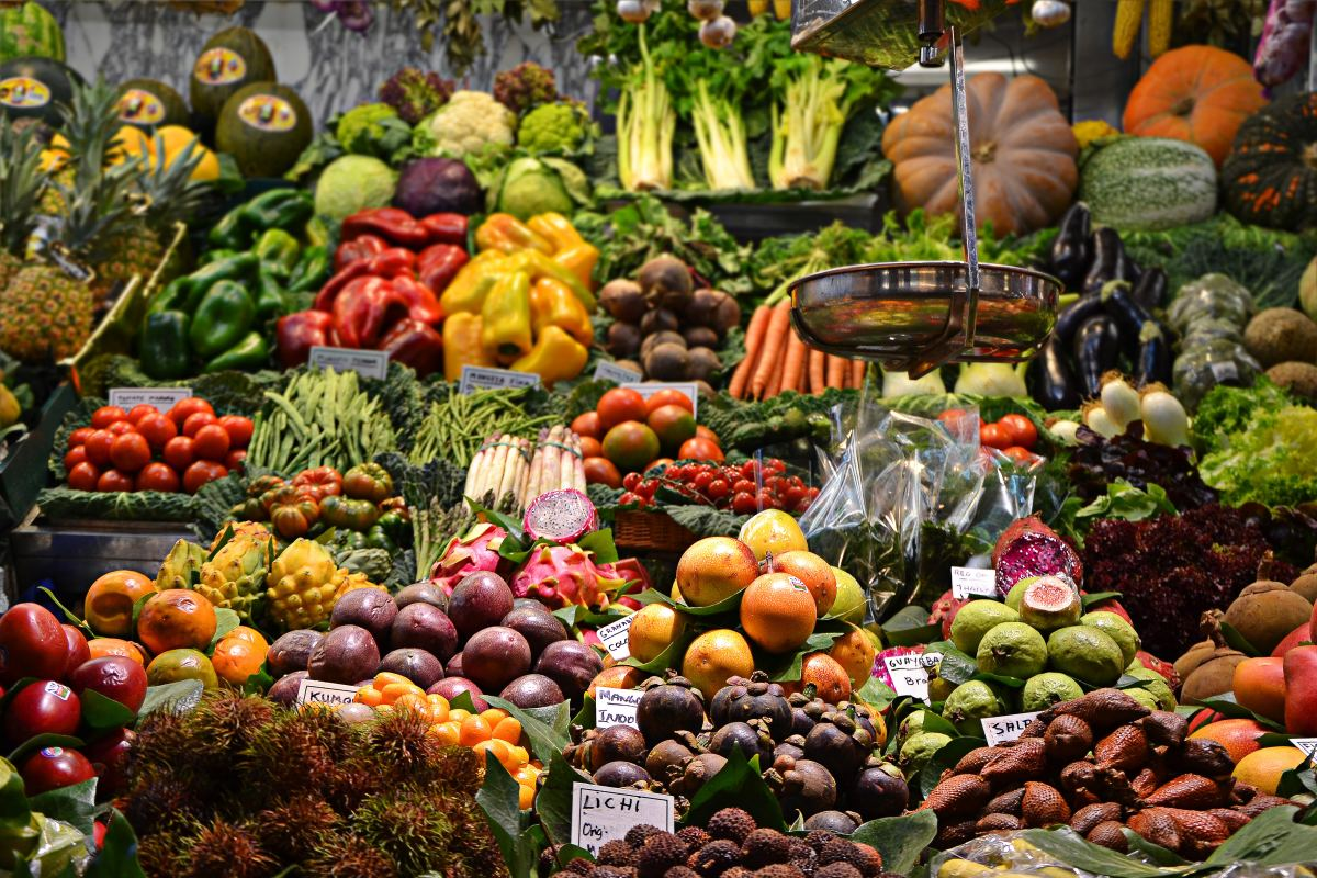 Piles of colorful fruits and vegetables.