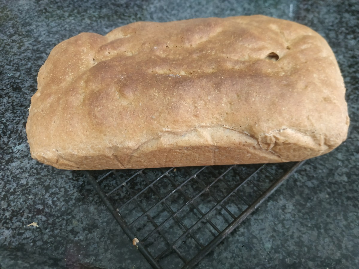 A loaf of spelt bread, fresh from the oven.