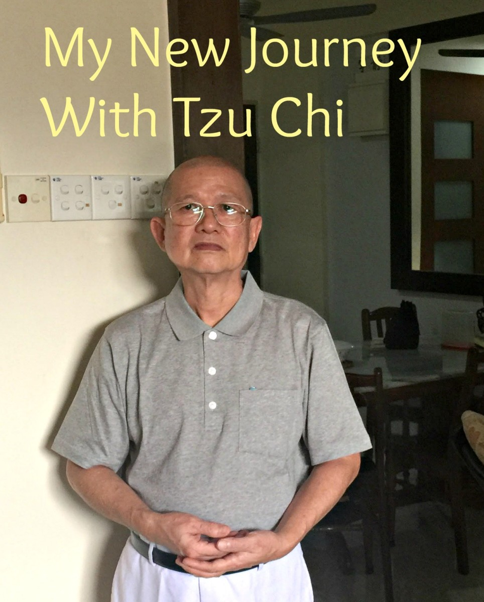 Author Good Guy, with the signature Tzu Chi post with clasp palms.