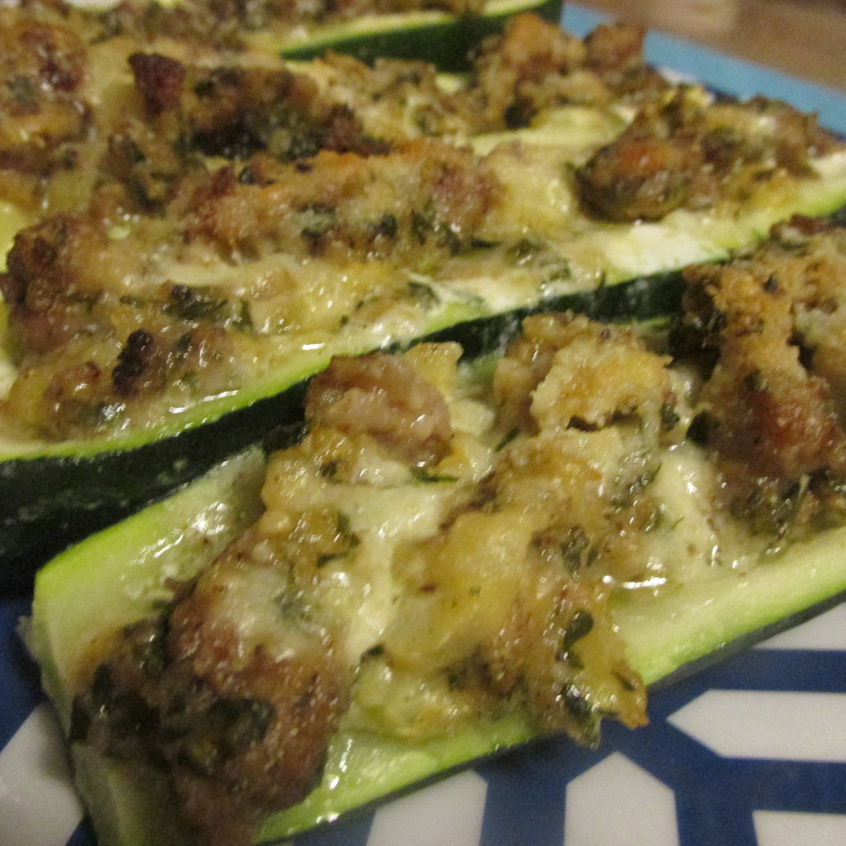 Zucchini stuffed with sausage filling, hot and ready to eat
