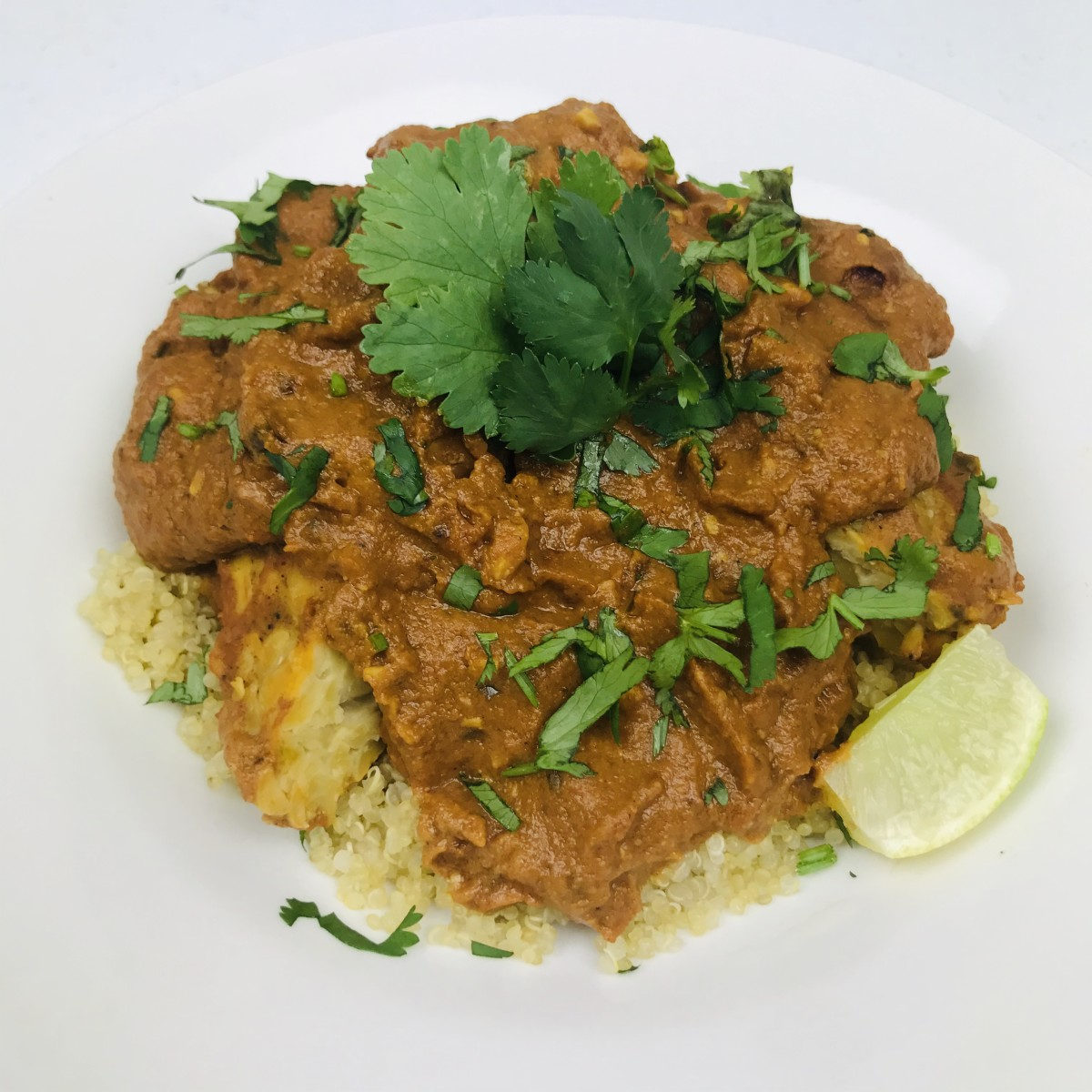 Tempeh tikka masala served with quinoa.