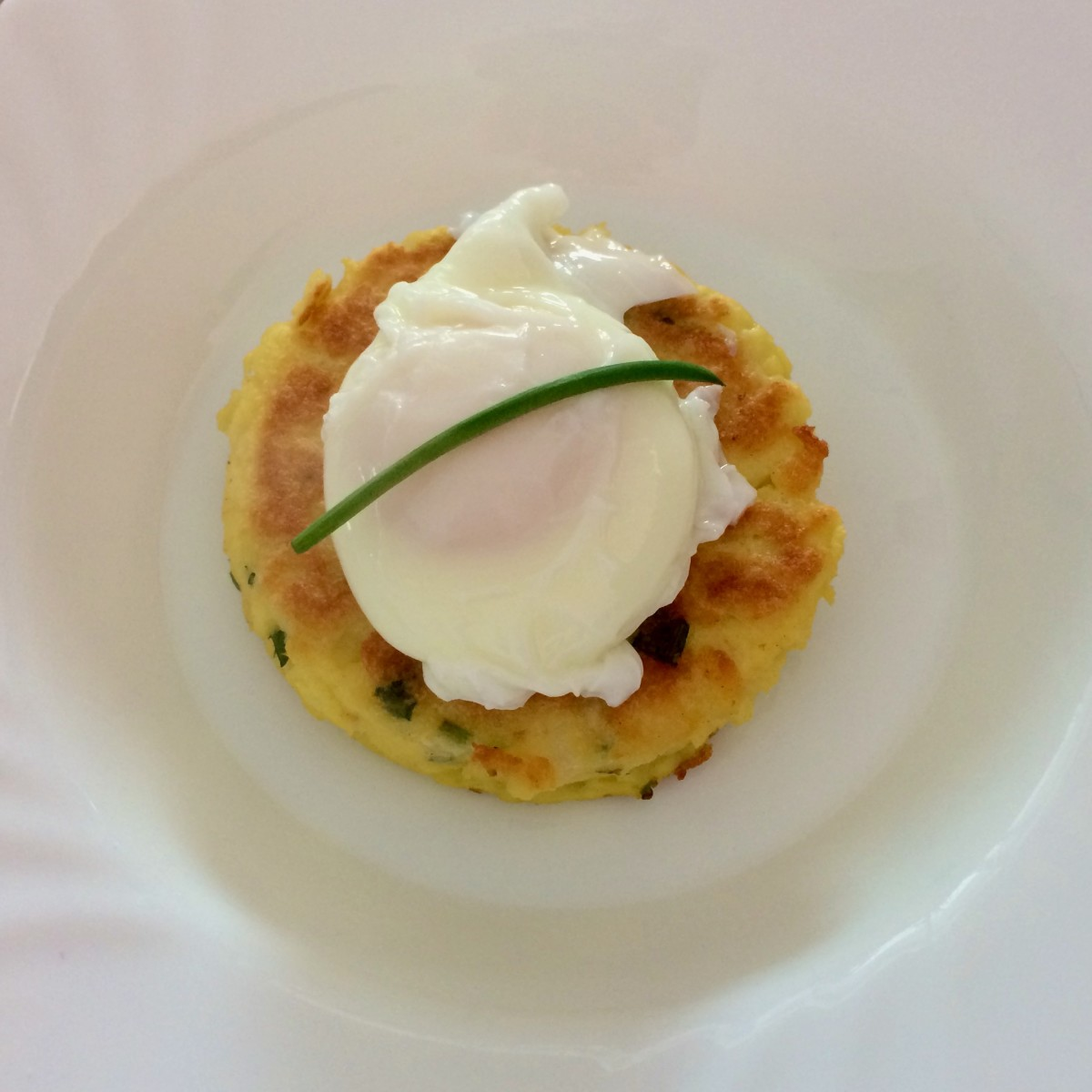 Potato cake with a poached egg