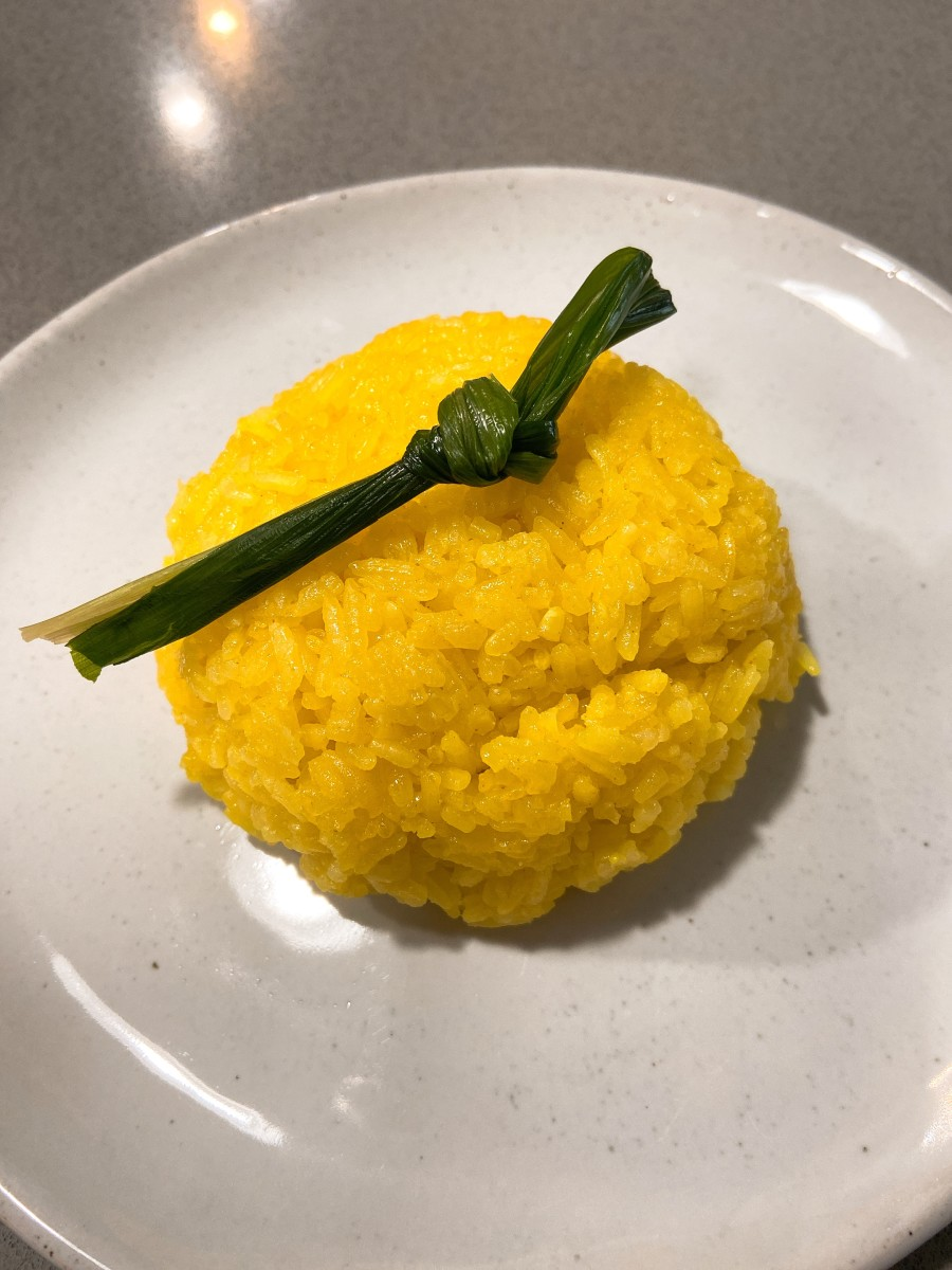Turmeric glutinous rice, or pulut kuning, is a very popular and tradtional Malay dish. It's usually served with beef or chicken rendang.