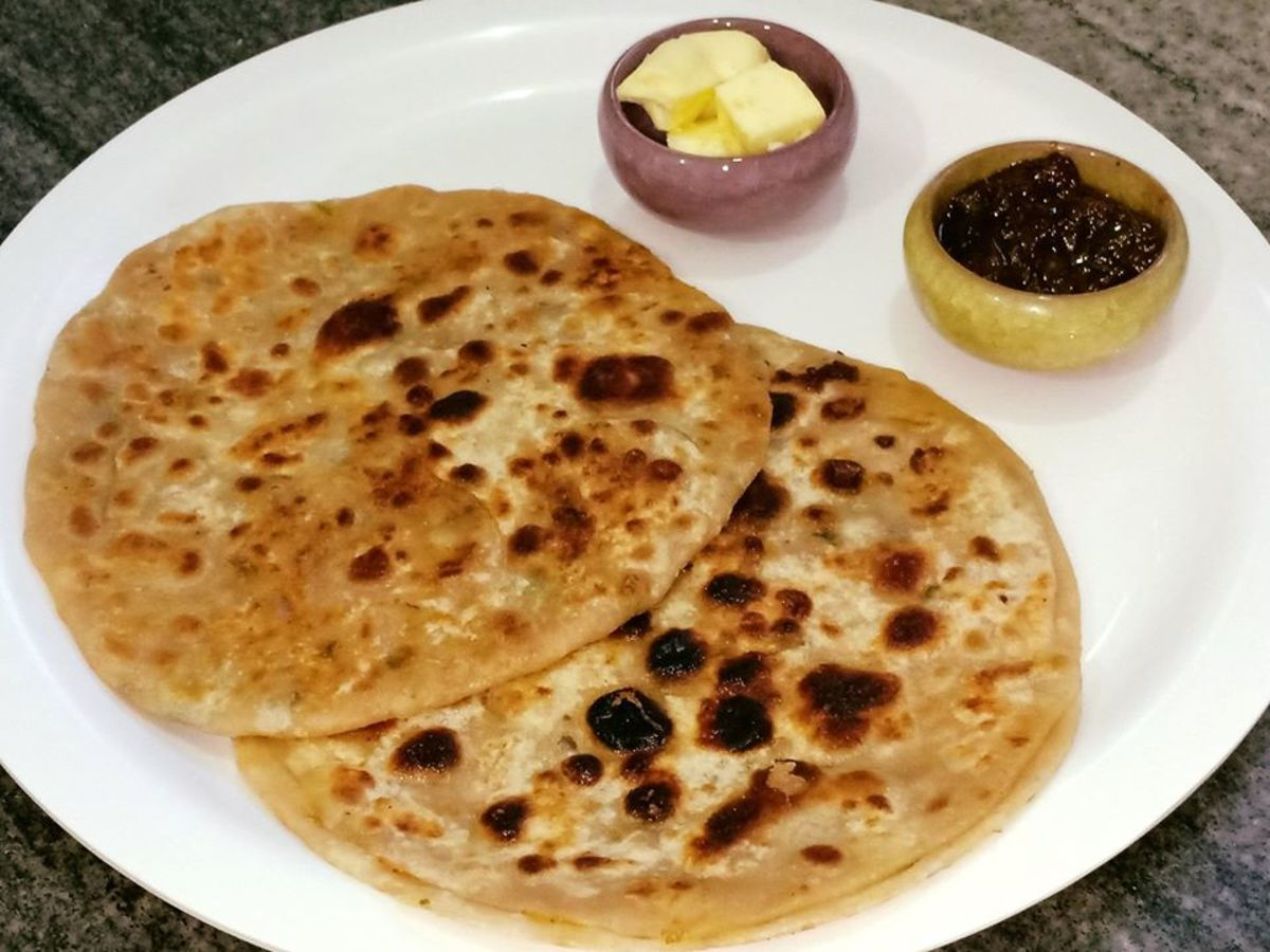 Aloo paratha is a traditional Punjabi breakfast dish, usually served with butter, lemon or mango pickle, and lassi.