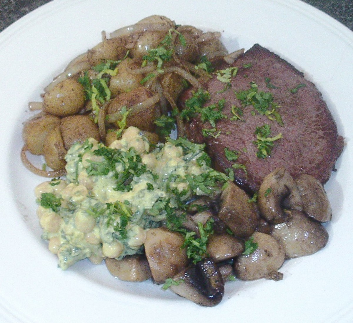 This beef steak with fried potatoes and onions, garlic mushrooms and spicy chickpeas salad is just one of the recipes to be found on this page
