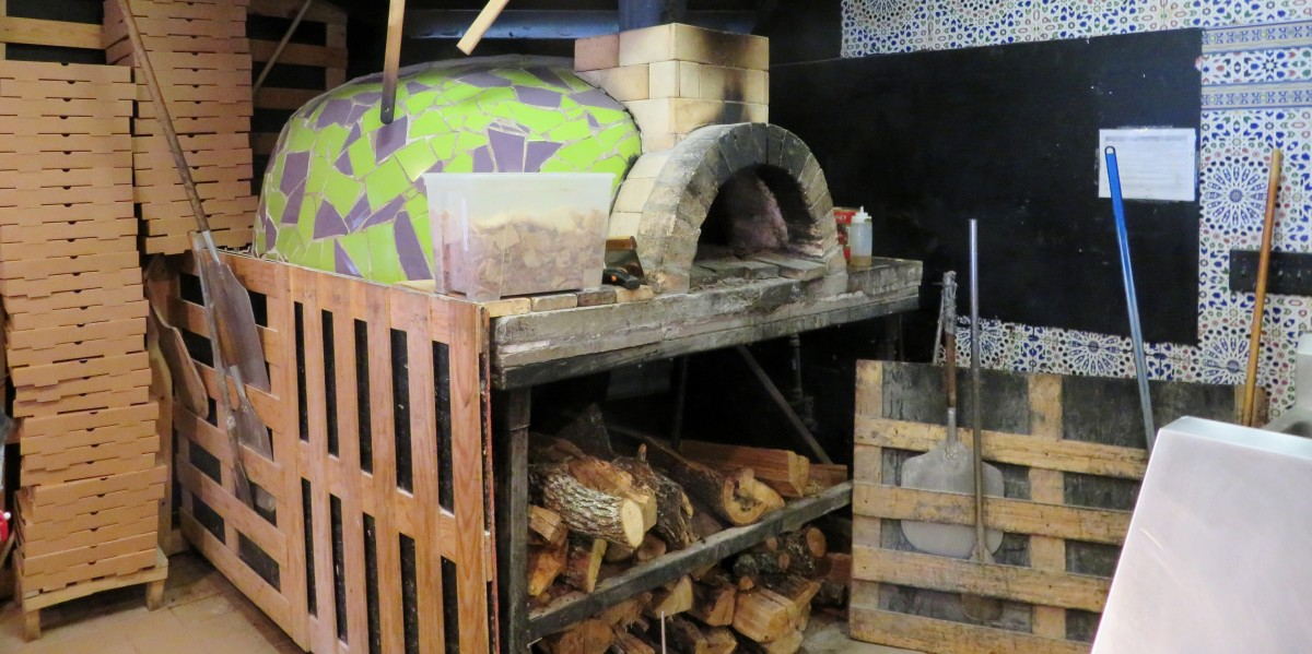 Wood-fired oven inside of El Canton Firewood Pizzeria