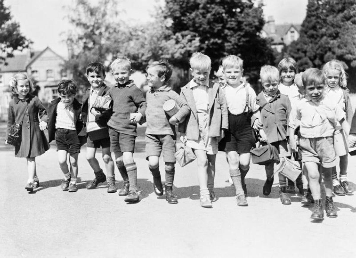 Children evacuees such as girls wore dresses and often had there hair in pig tails or plats.Children evacuees such as boys wore long socks and shorts with a white shirt and often wore an old fashioned cap.