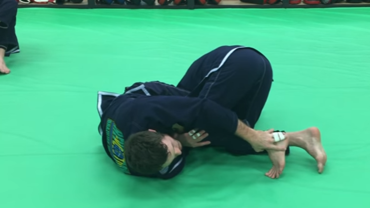 How to Do a Belly Down Armbar from Guard in BJJ
