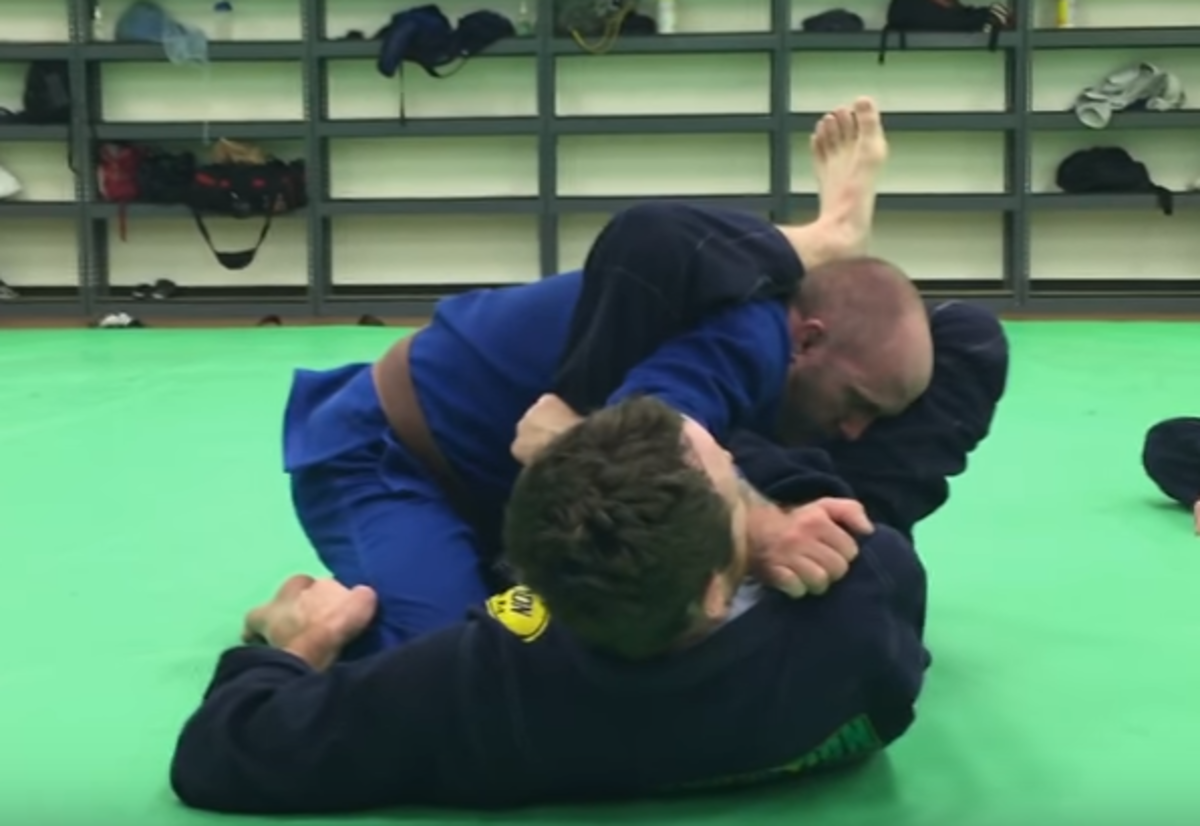 Using an armbar from the guard.