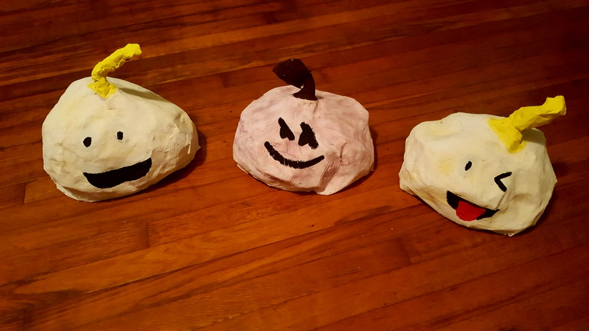 Paper Mache Emoji Pumpkin Sculptures.