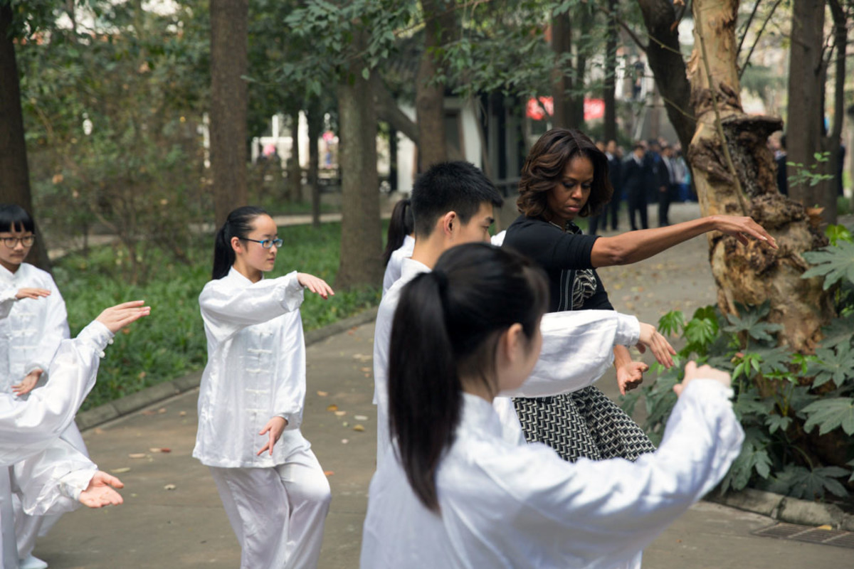 First Lady Michelle Obama participates in tai chi with students from Number 7 School in Chengdu, China on March 25, 2014.