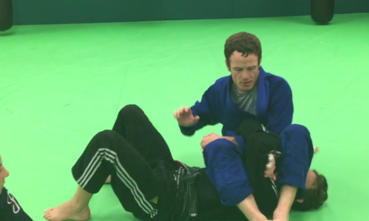 Finishing an armbar with the RNC grip.