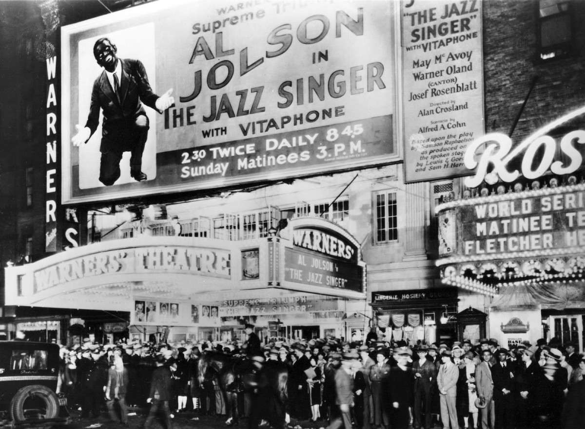 The crowd outside a theater showing Al Jolson in The Jazz Singer - the first Hollywood talking picture show.