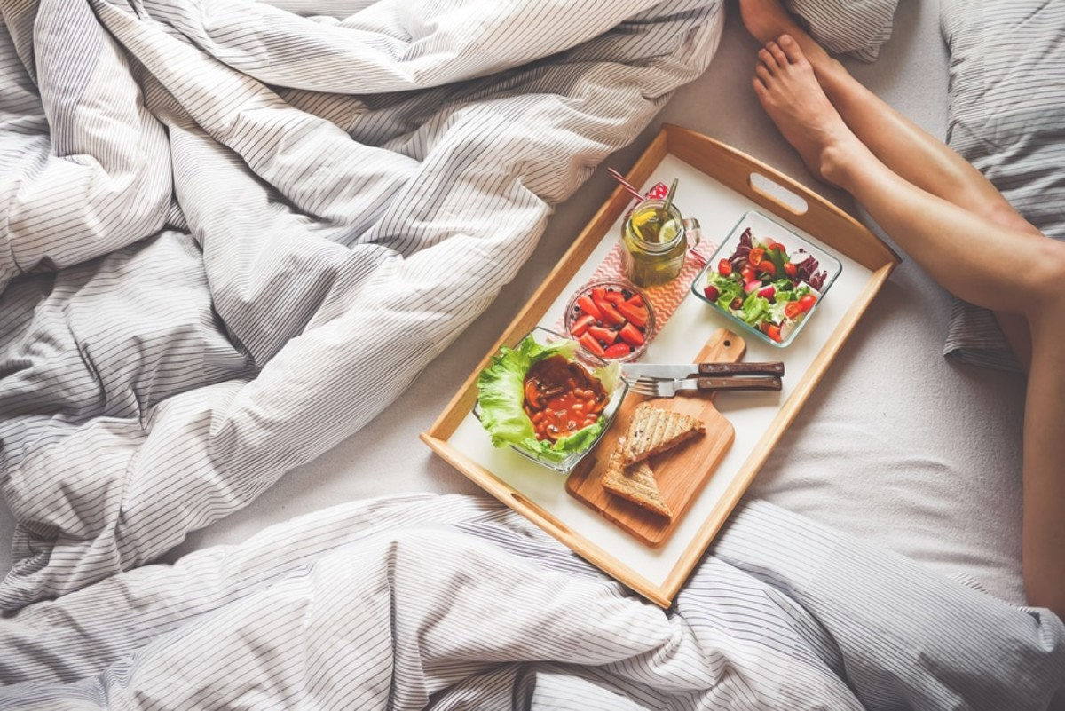 Breakfast in bed is fine as a very occasional treat. Otherwise, NO eating in bed!