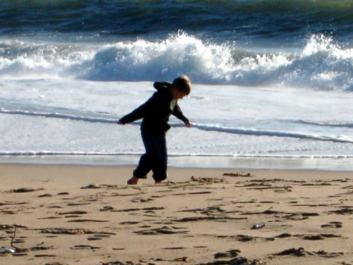 This my oldest son, waking into the wind near the ocean in January in Southern California one year.  This is near the wedge in Balboa, Newport Beach.
