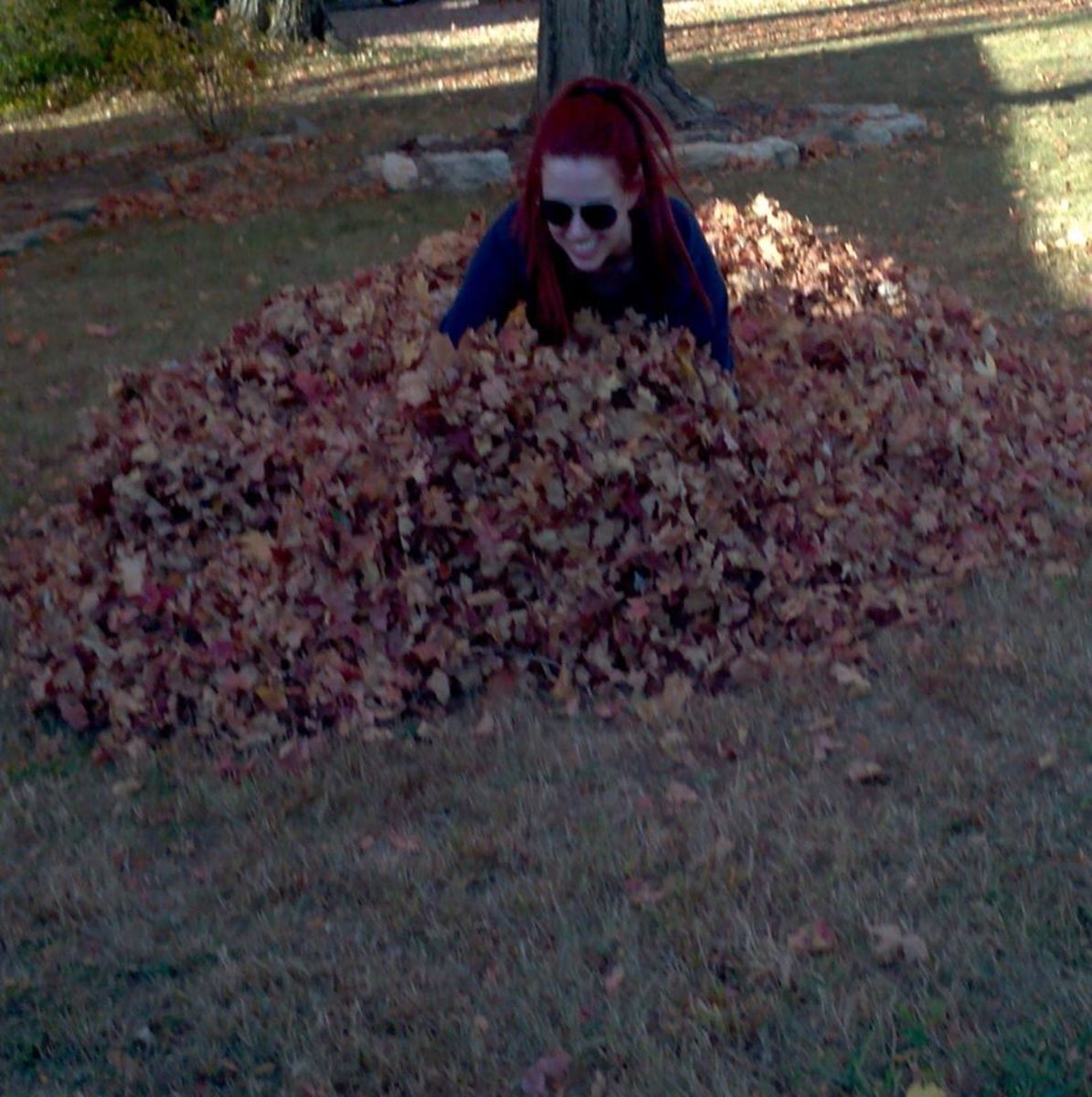 You're never too old to jump into a leaf pile!