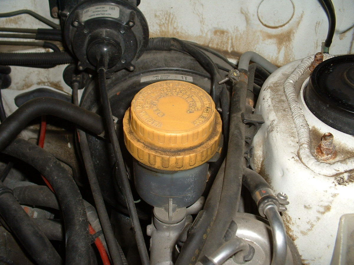 The brake master cylinder is located at the back of the engine compartment.