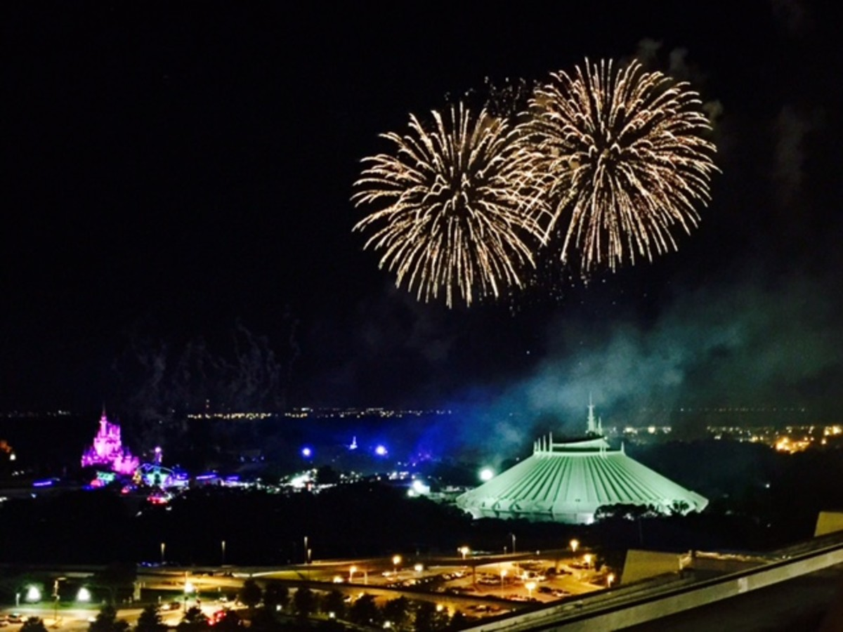 View of Magic Kingdom fireworks from the outside viewing deck of the restaurant.