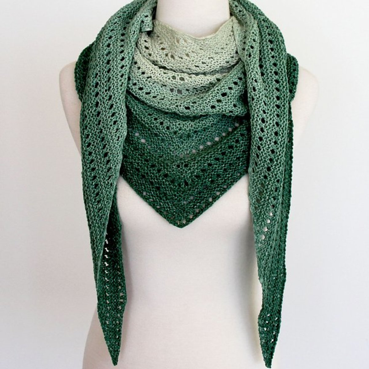 Knit shawl with a green ombre palette.
