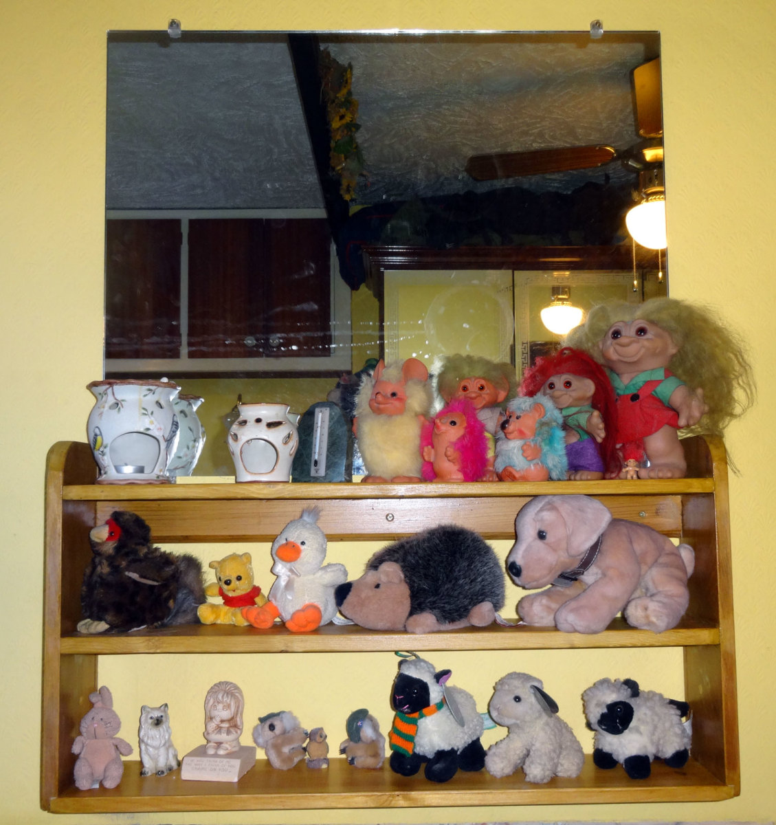 Shelving unit for wall mounted mirror