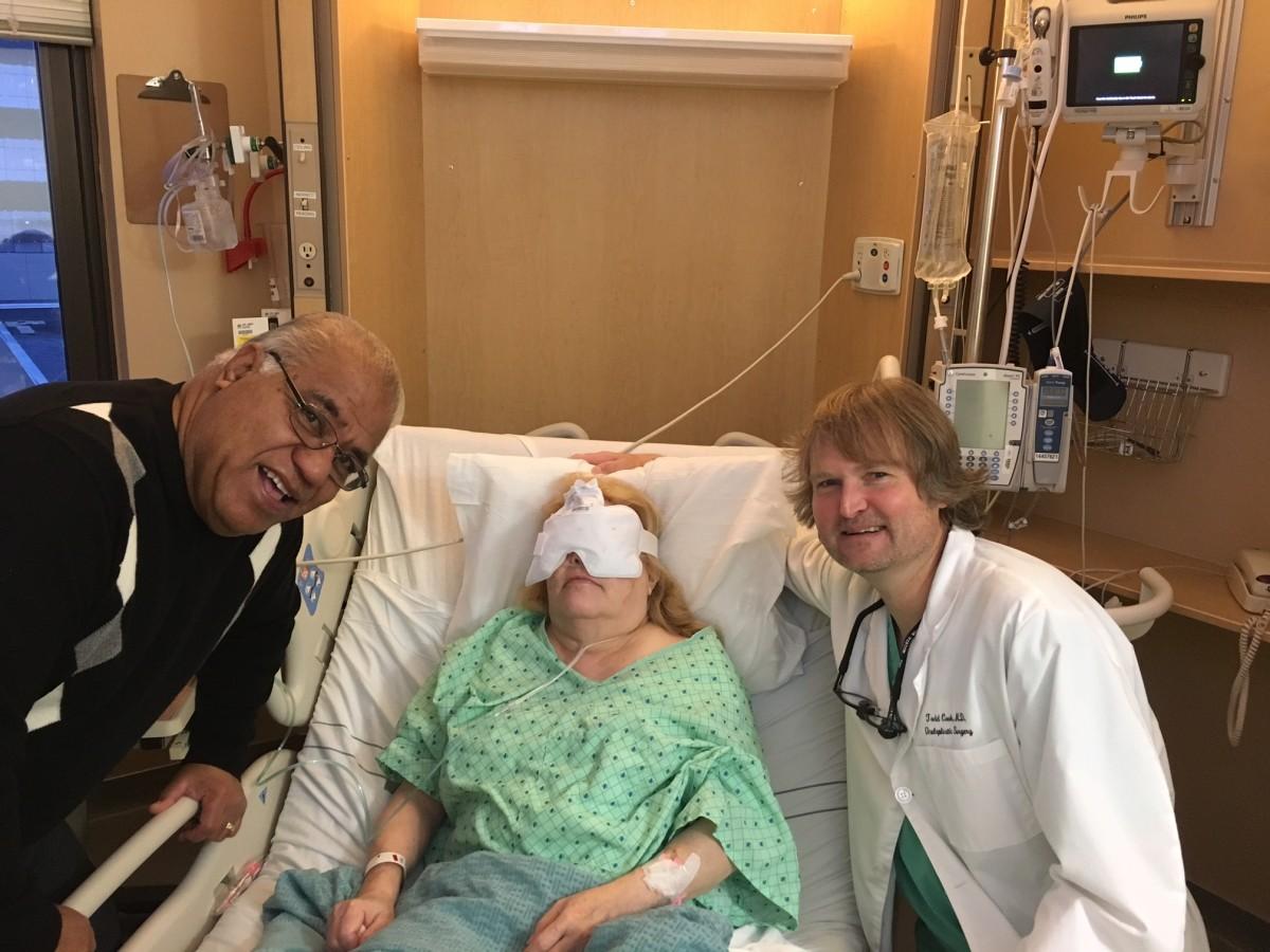 My husband, me, and my eye surgeon.