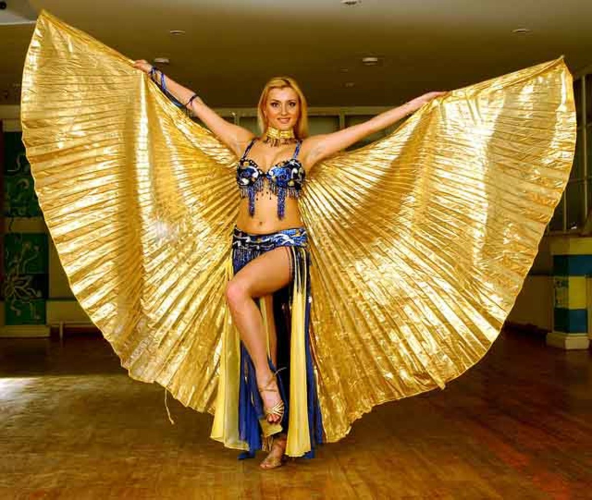 An Egyptian style dancer performing with Isis Wings constructed from lame fabric.