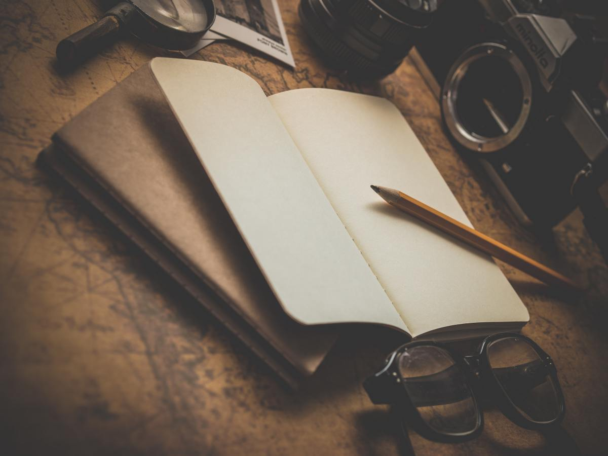 A blank notebook and a wooden pencil are simple gifts any writer would love.