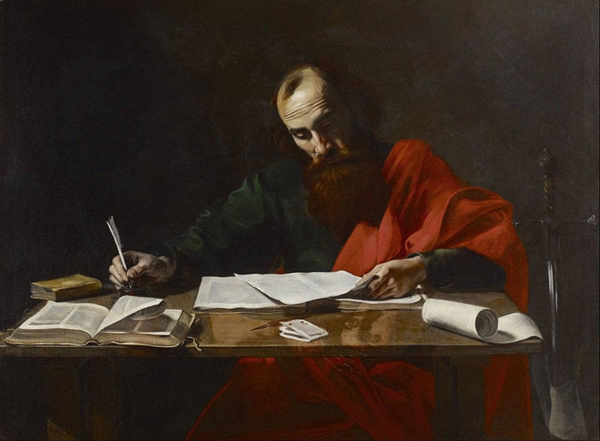 The Apostle Paul writing his epistles.