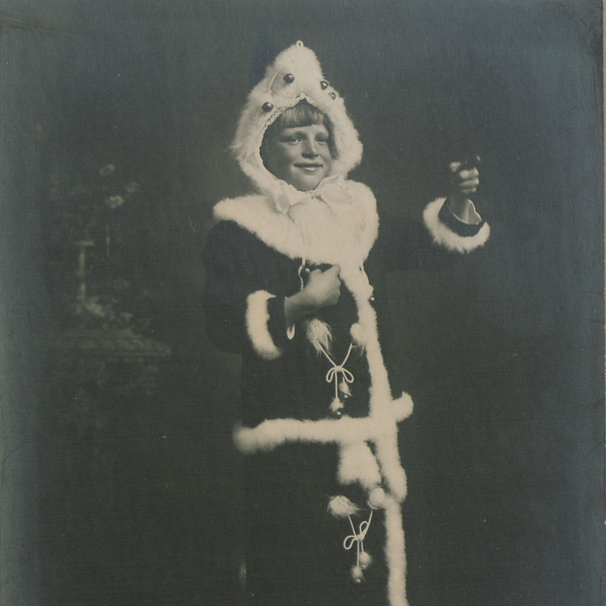 A girl dressed as Santa in 1915.