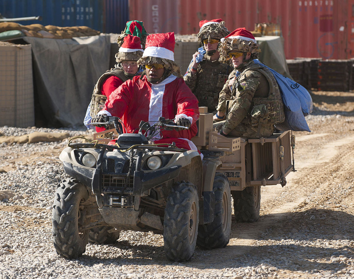 Soldiers delivering Christmas mail to their fellow soldiers.