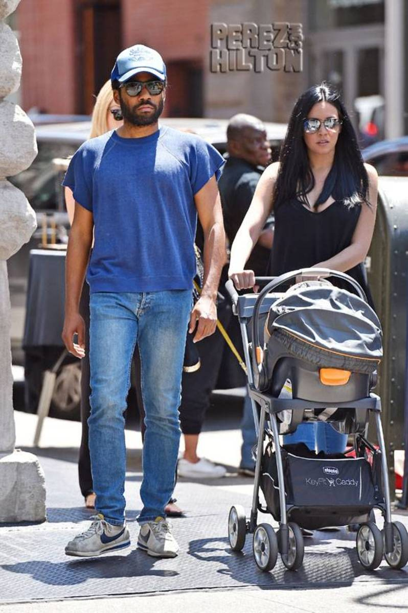 Childish Gambino and his unidentified girlfriend pushing a stroller earlier this year.