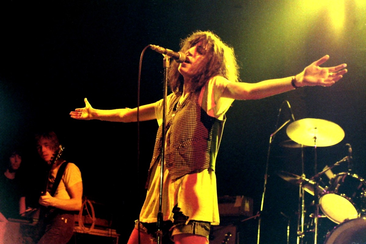 Patti Smith performing in Germany in 1978, from wikipedia, photo by Klaus Hiltscher