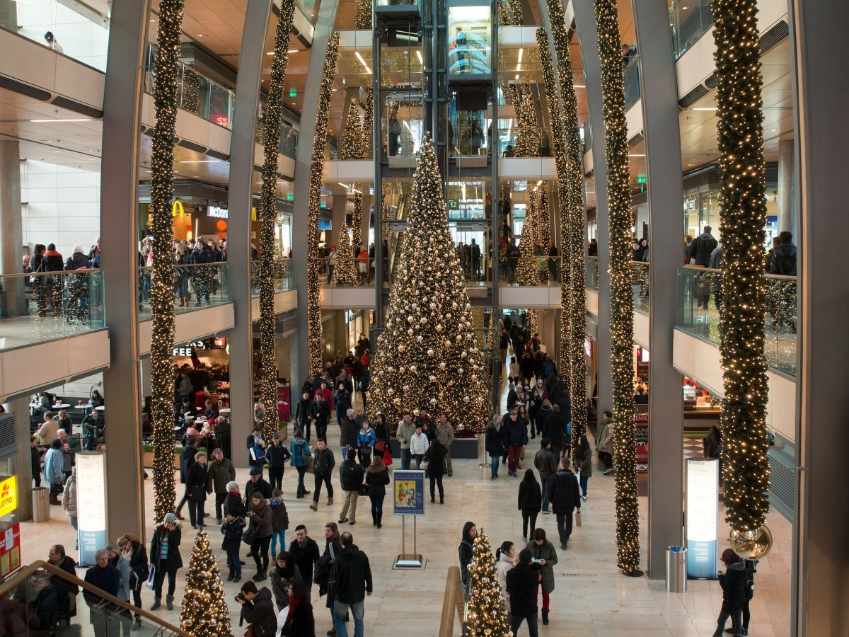 The temptation to spend too much money on Christmas presents, food, and social activities is everywhere.