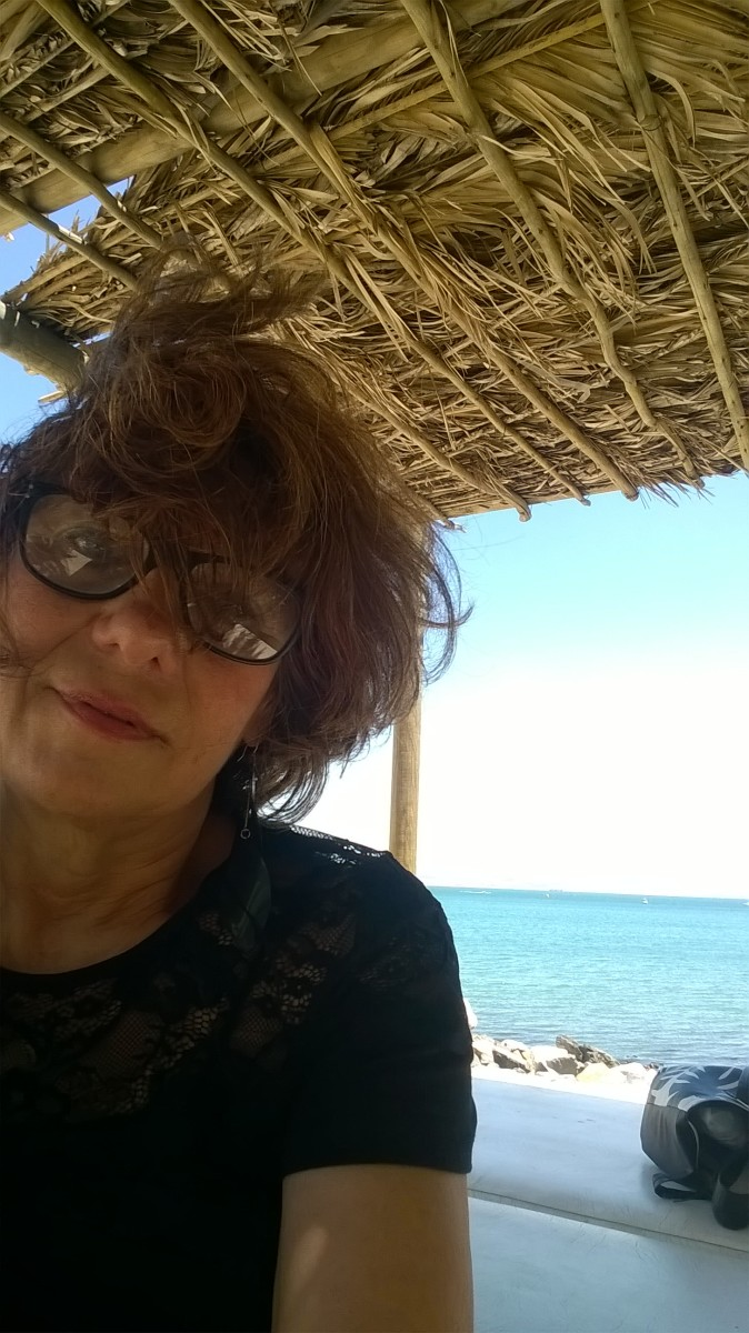 Me, age 65, on the beach, wind-blown, no makeup, Cape Town, South Africa!