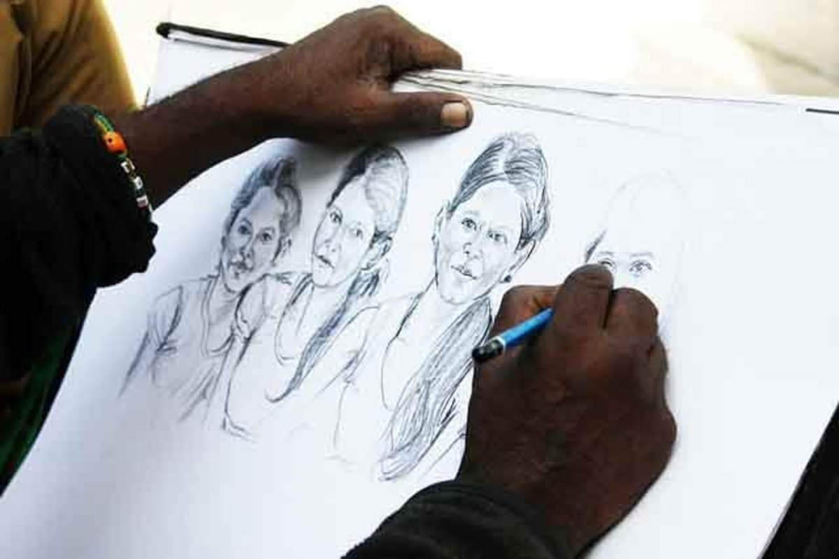 Artist sketching human faces.