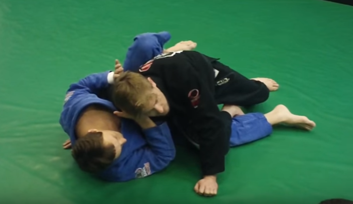 Using the knee cut guard pass.