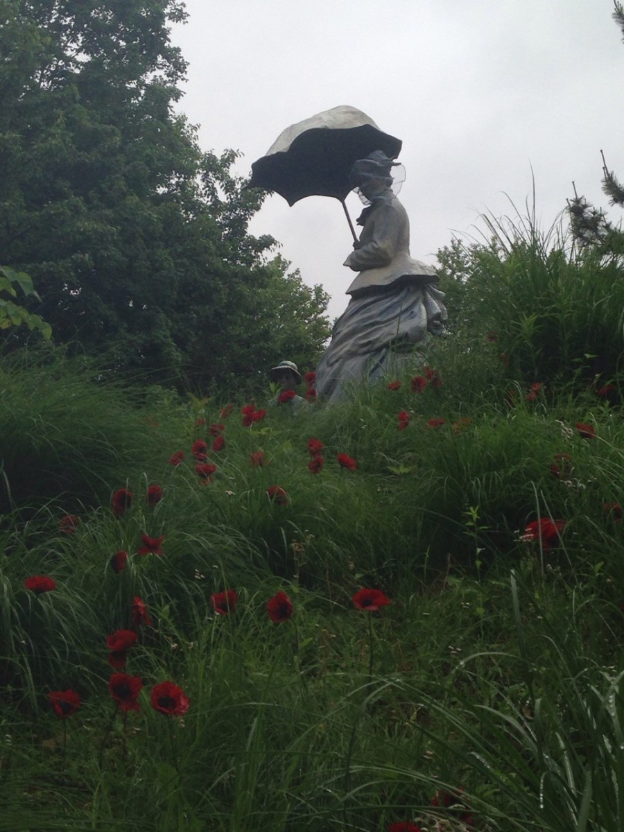 "Grounds for Sculpture's 'On Poppied Hills' (artist Seward Johnson) inspired by Monet's ""Lady with a Parasol"""