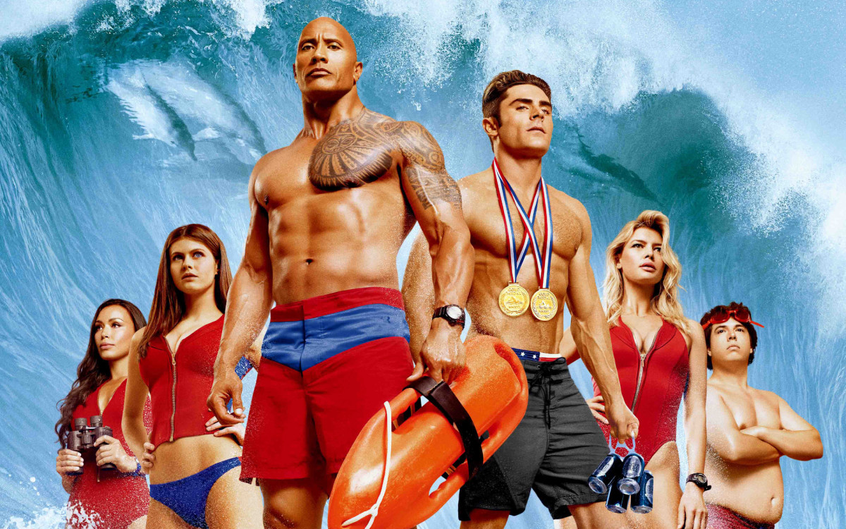 "The cast of ""Baywatch."" From left to right: Ilfenesh Hadera, Alexandra Daddario, Dwayne Johnson, Zac Efron, Kelly Rohrbach, and Jon Bass."