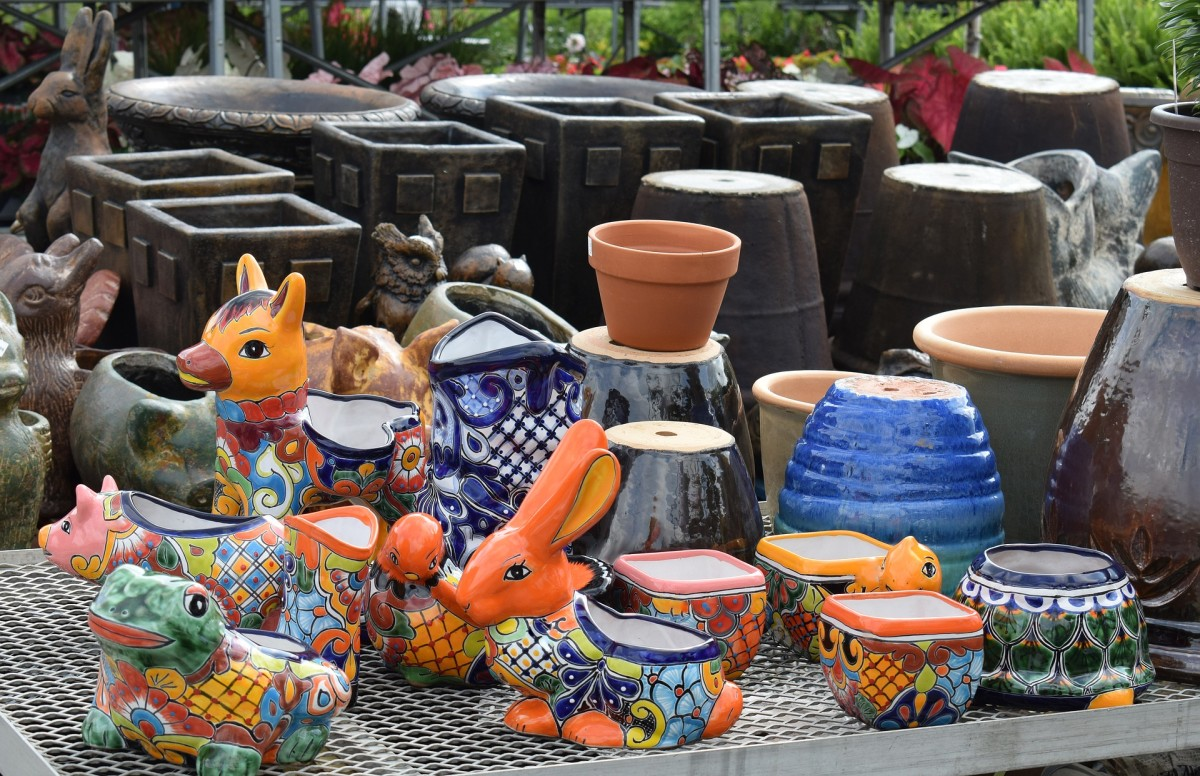 A colorful ceramic plant pot could be used as your container.