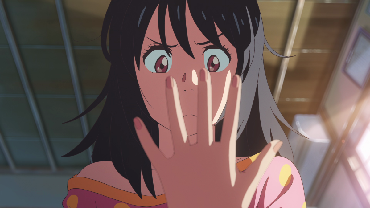 Taki, waking up in Mitsuha's body, is perplexed by many new sensations.